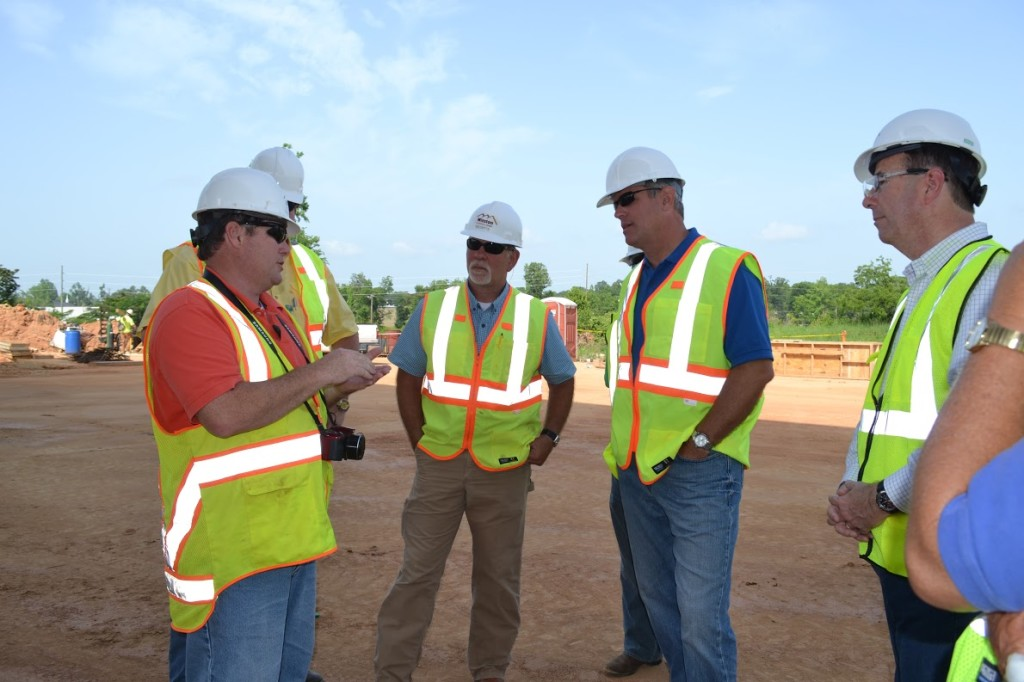 Speaker of the Mississippi House of Representatives, Philip Gunn (second from the right) tours the construction site.